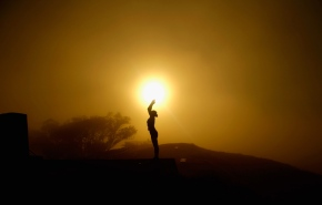 AUCKLAND, NEW ZEALAND - MAY 04:  A lady practices yoga on the summit of Mt Eden as the sun struggles to shine through a blanket of fog over Auckland City on May 4, 2016 in Auckland, New Zealand. The morning fog disrupted flights and ferry services in the city.  (Photo by Phil Walter/Getty Images)